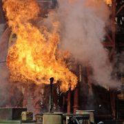 a factory burning despite fire resistant paint