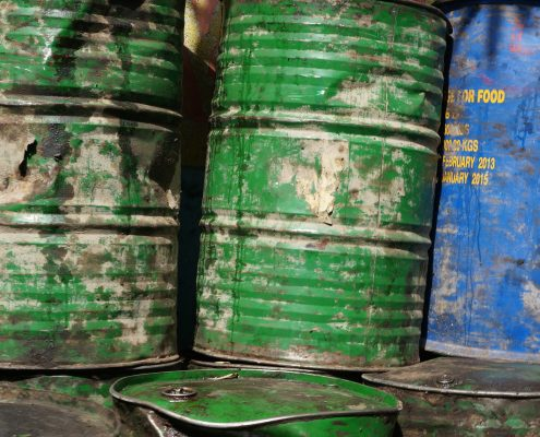 chemical resistant coating in blue and green barrels