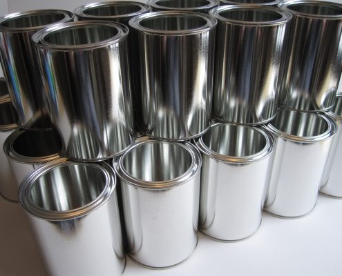 empty paint cans waiting for packaging coatings