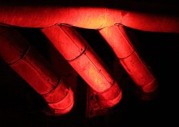 heat resistant coating on red pipes in ceiling